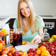 Girl making cocktail with fruits and ice — Stock Photo #38695043