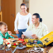Happy family together doing something with working tools — Stock Photo
