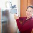 Stock Photo: Mature womcleaning glass