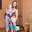 Stok fotoğraf: Family chores with vacuum cleaner in home