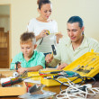 Happy family of three doing something — Stock Photo #38695125
