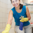 Smiling mature womcleans bathroom — Stock Photo #38695143