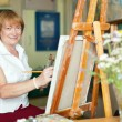Female artist paints anything — Stock Photo #38695145