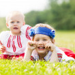 Two children in traditional folk clothes — Stock Photo #38695199