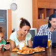 Couple with teenager son during breakfast — Stock Photo