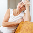 Stock Photo: Sad mature woman having headache