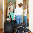 Couple with son with luggage near door — Stock Photo #38695329