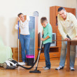 Couple with teenager dusting together — Stock Photo #38695389
