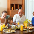Lovely happy multigeneration family having healthy dinner — Stock Photo