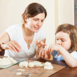 Stock Photo: Happy mother and baby sculpting from plasticine or dough in home