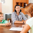 Son and father answer questions of social worker — Stock Photo #38695429
