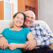 Stock Photo: Laughing mature womwith elderly husband