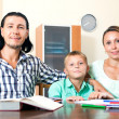Happy family doing homework — Stock Photo