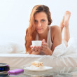 Stock Photo: Girl with mug of cafe in bed