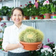 Happy florist with cactus — Stock Photo #38695609