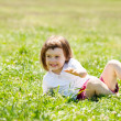 Three year old child playing at grass — Stock Photo #38695639