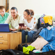Family of three reserving hotel on internet — Stock Photo #38695641