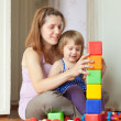 Pregnant mother plays with child — Stock Photo #38695659