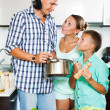 Happy family cooking veggie lunch — Stock Photo