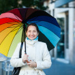 Laughing mature womwith umbrella — Stock Photo #38695717
