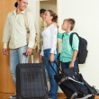 Happy family of three leaving home — Stock Photo #38695781