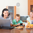 Smiling family communicating over breakfast — Stock Photo #38695807