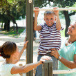 On pull-up bar at playground — Stock Photo