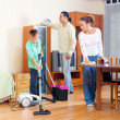 Parents and boy cleaning together — Stock Photo #38696117