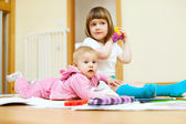 Children sits in home — Stock Photo