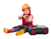 Child in builder hardhat with tools — Stock Photo