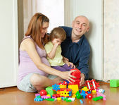 Happy parents and child in home — Stock Photo