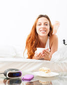 Beautiful girl drinking cafe in bed — Stock Photo