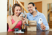 Couple with new compact digital camera — Stock Photo