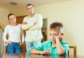 Teenage son and parents having quarrel — Stock Photo