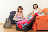 With luggage looking clothes for a great holiday — Stock Photo