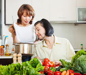 Flirting couple cooking together — Stok fotoğraf