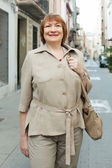 Mature woman at european town — Stock Photo
