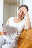 Sadness woman with newspaper — Stock Photo