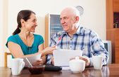 Joyful mature couple with documents — Stock Photo