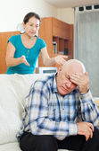 Upset senior man against angry wife — Stock Photo
