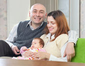 Happy man with wife and newborn baby — Stock Photo