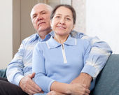 Happy mature couple in home — Stock Photo