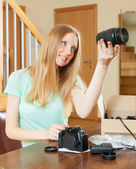 Woman with new digital camera at home — Stock Photo