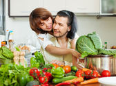 Loving couple cooking vegetables — Stock Photo