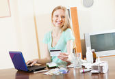 Happy long-haired woman buying drugs online — Stock Photo