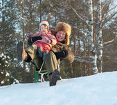 Happy father with 2 years child playing on slide — Stock Photo