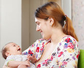 Happy mother with her 3 month baby — Stock Photo