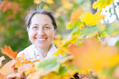 Portrait of happy woman in autumn — Photo