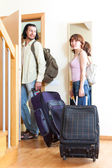 Positive couple of travelers with luggage in home going on holid — Stock Photo