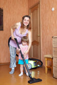 Family chores with vacuum cleaner in home — Stok fotoğraf